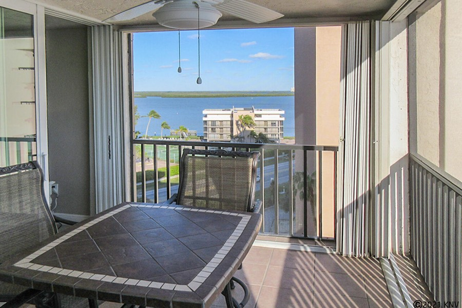 Screened In Lanai has a spectacular view of the Gulf and Bay