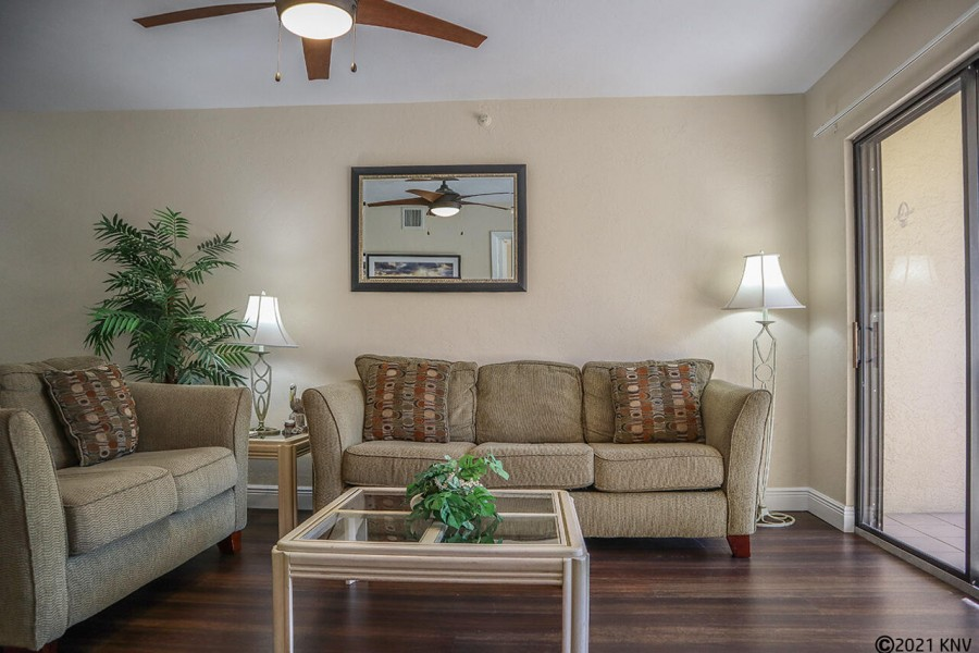 Comfy seating in the living area to watch the large screen TV. Ceiling fan and unit A/C keeps things