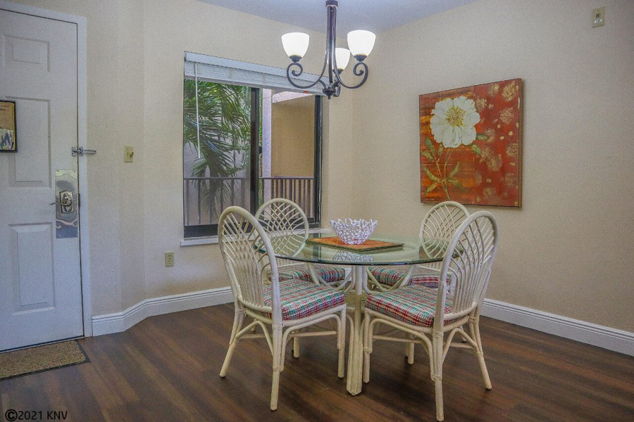 Dining Area offers a glass table for 4.