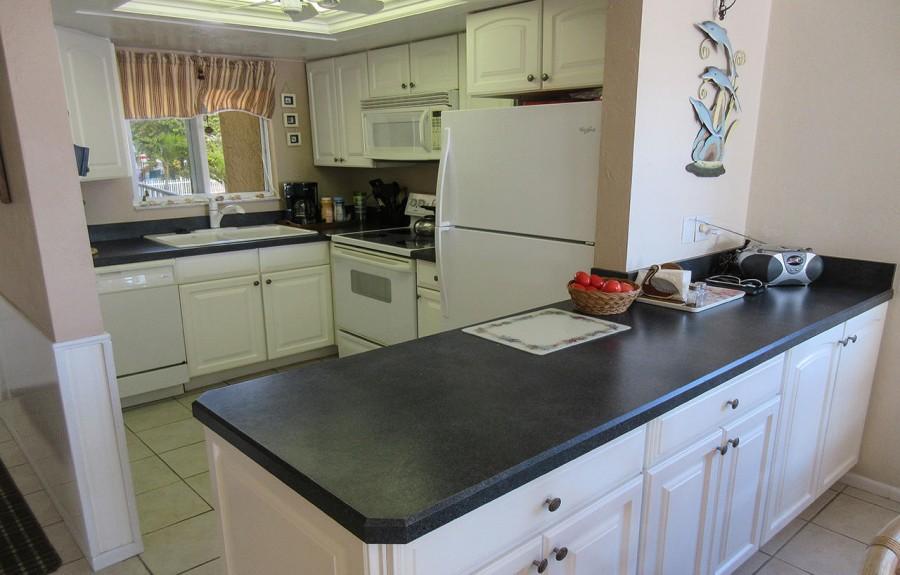 Estero Sands 103 Kitchen - Open the windows to enjoy the sea breezes