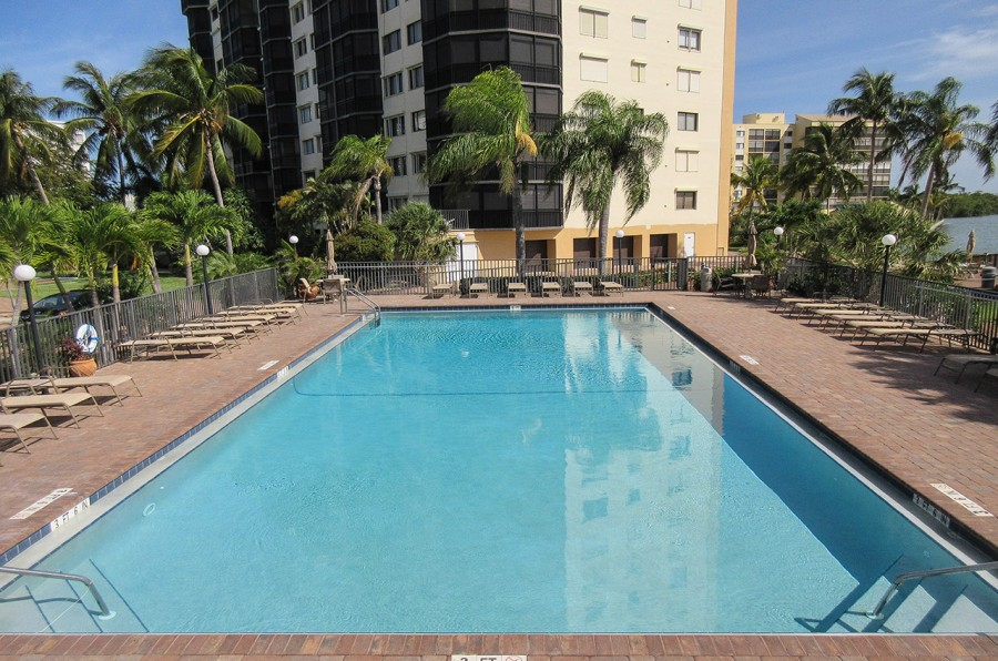 Harbour Pointe Resort Condominiums - Heated Pool Overlooking the Bay with Plenty of Lounge Chairs. H