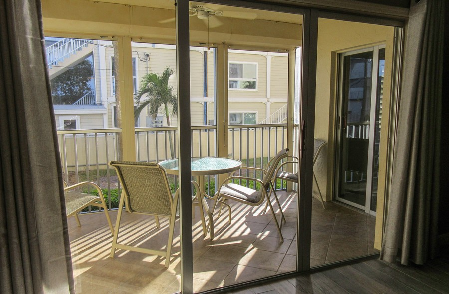 Sand Caper 108 Screened In Lanai overlooking the grounds