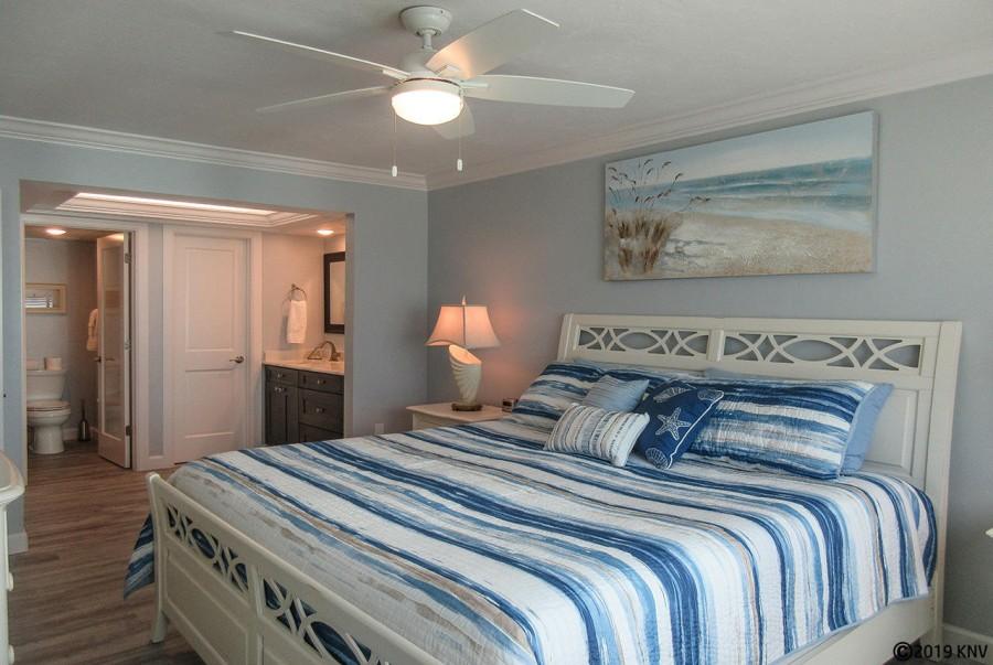 Riviera Club 406 Master Bedroom has a private lanai access and en suite bath