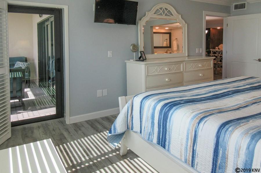 Riviera Club 406 Master Bedroom has a private lanai access