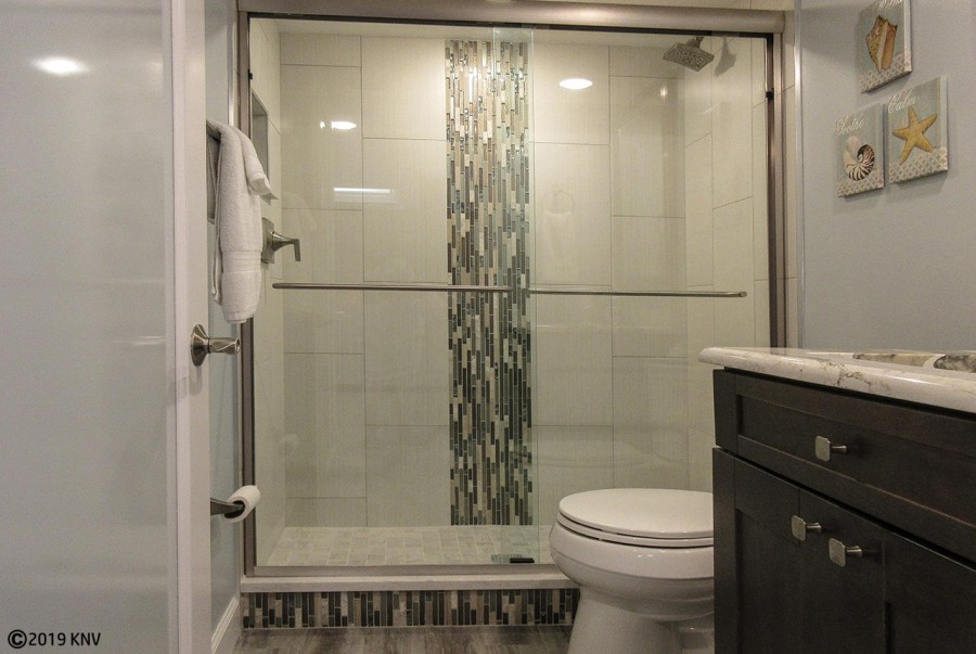 Beautifully remodeled Guest Bath with tiled walk in shower