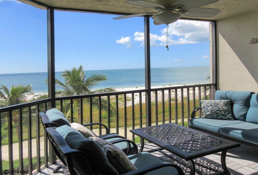 Comfortable seating to enjoy the Gulf breezes from your screened in lanai