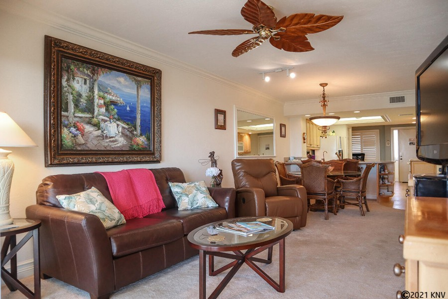 Comfortable seating and large screen TV in the living area at Harbour Pointe 1014S