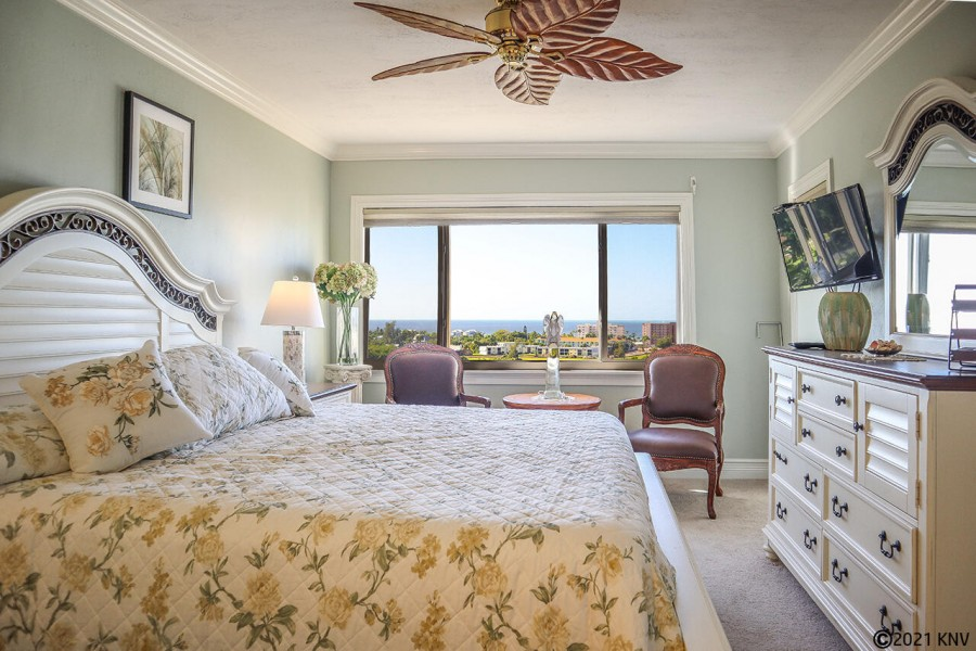 King Sized Bed, TV, and Private Lanai Access in Master Bedroom