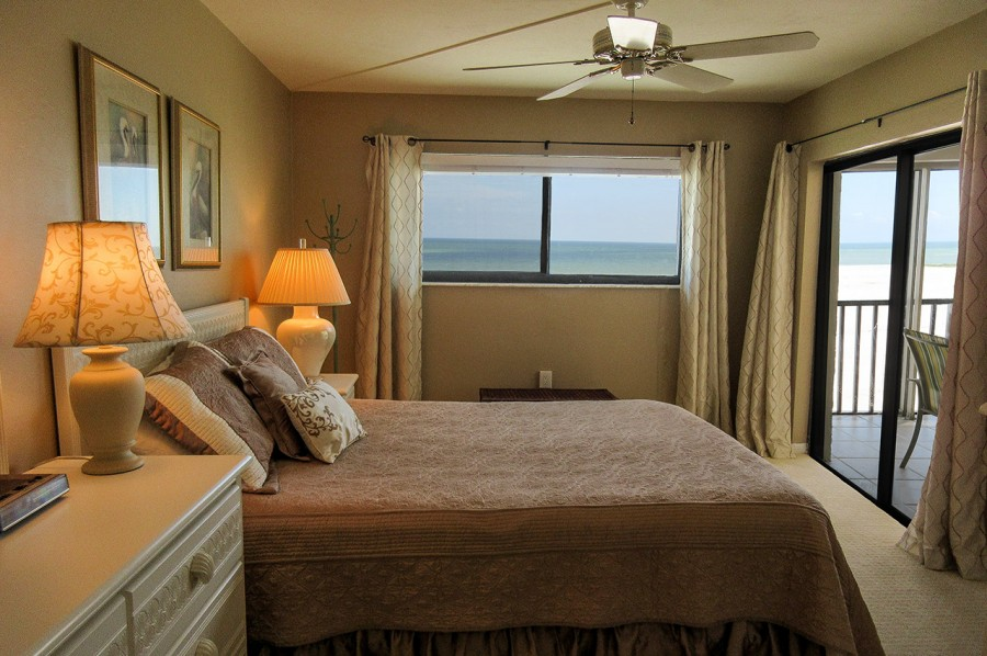 Carlos Pointe 512 Master Bedroom has private lanai access