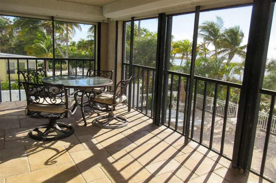 Corner unit lanai offers a panoramic view of sunrise and sunsets on the beach