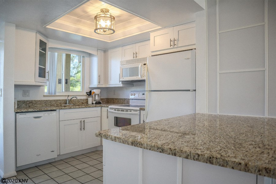 Fabulous newly remodeled kitchen features new appliances and granite countertops