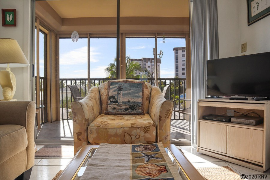 Large screen TV and comfortable seating with a lovely view of the Gulf.