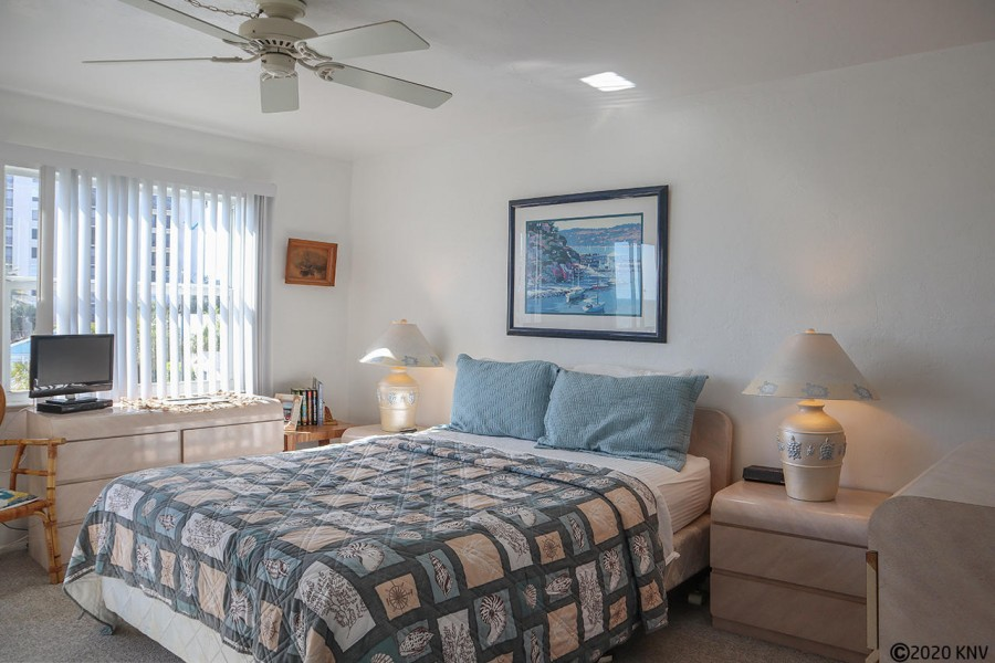 Master Bedroom has a ceiling fan and queen sized bed.