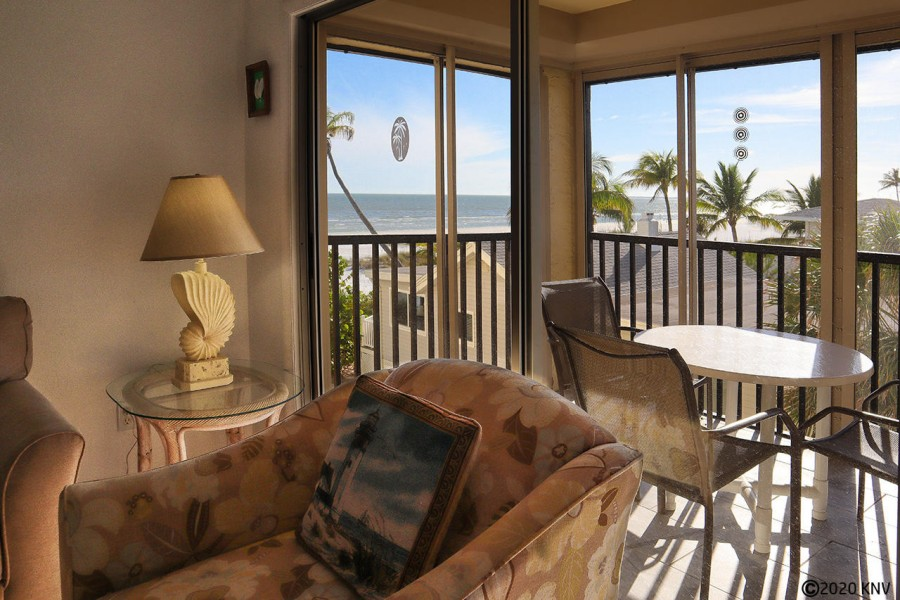 Sliding glass doors in the living room lead out to a screened in lanai.