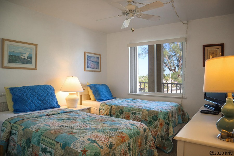 Guest Bedroom has a ceiling fan and two twin beds