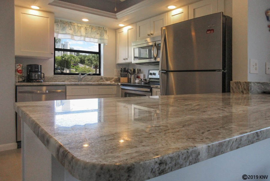 Marble Countertops and new appliances in the remodeled kitchen