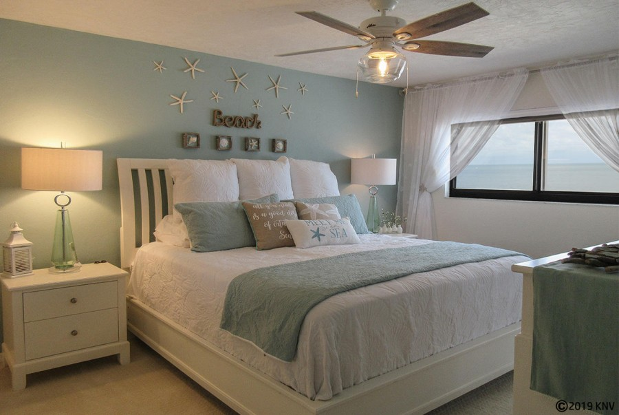 Magnificent Master Bedroom En Suite has a plush King-Sized Bed, decorated in island style.