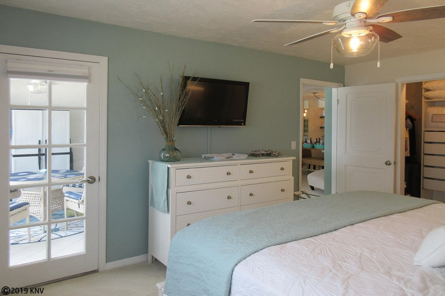 Master Bedroom En Suite offers a private lanai access and a Gulf view.