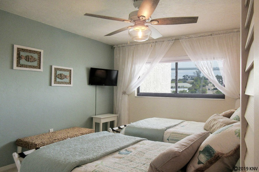 Two twin beds, a flat screen tv and a view of the bay...Guest Bedroom at Sunset 904