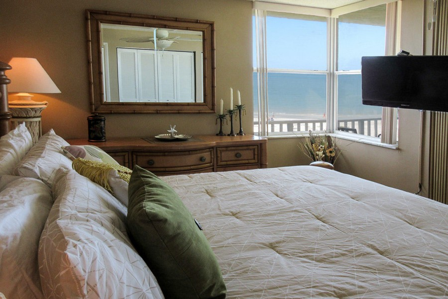 Bedroom has lovely view of the beach and TV