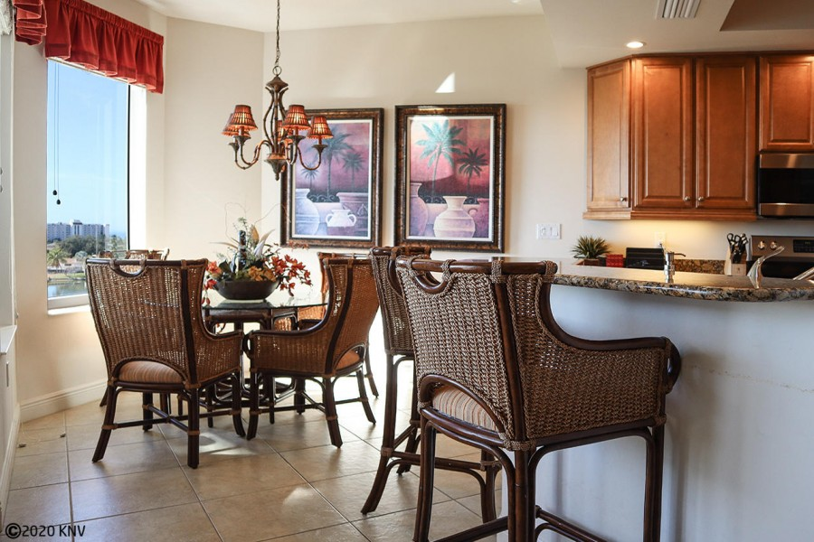 Dining Area includes glass top table for 4 and a breakfast bar.