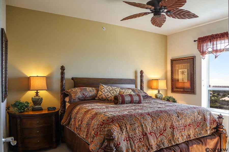 Gorgeous Master Bedroom features a ceiling fan, king sized bed and a beautiful view