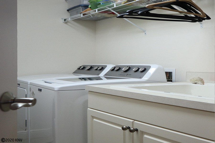 Waterside 785 features a laundry room with full sized washer and dryer
