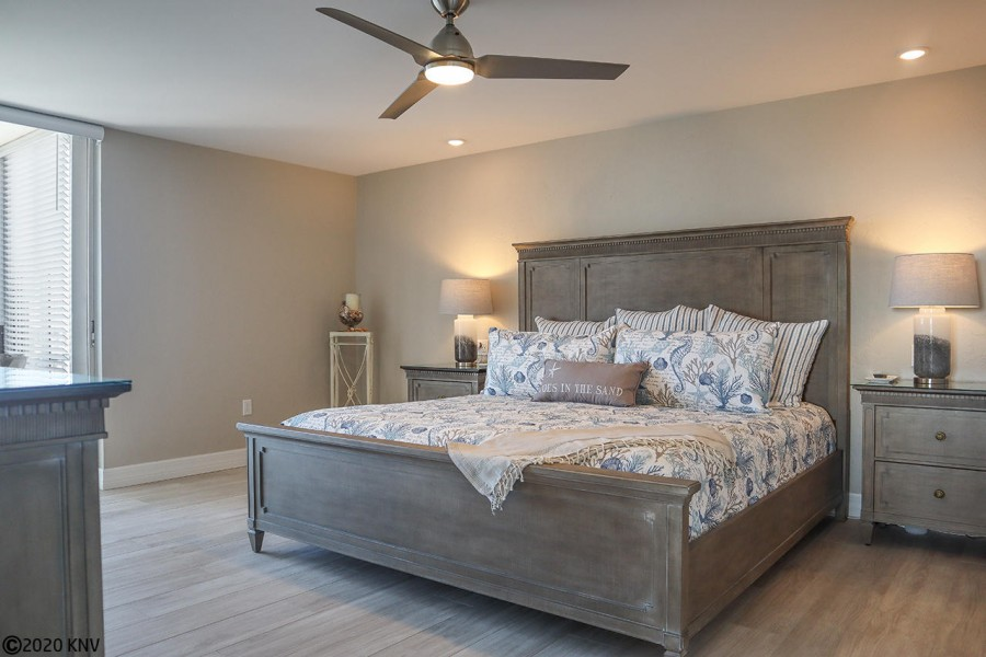 Beautiful Master Bedroom features its own ceiling fan and TV.
