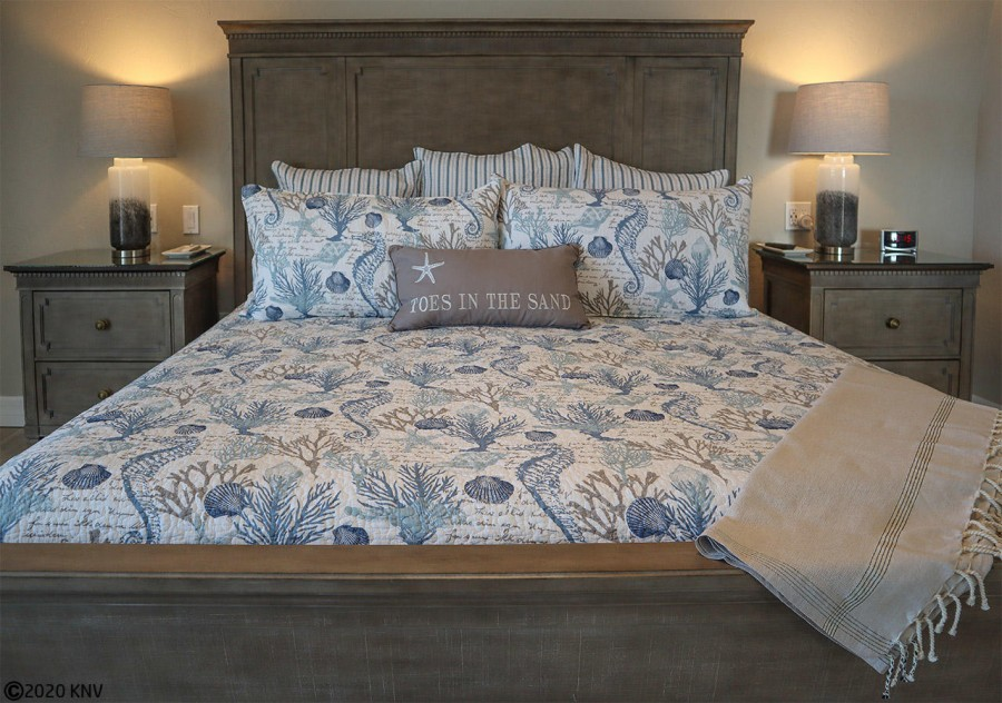 King Sized Bed welcomes you after your active day at the beach.