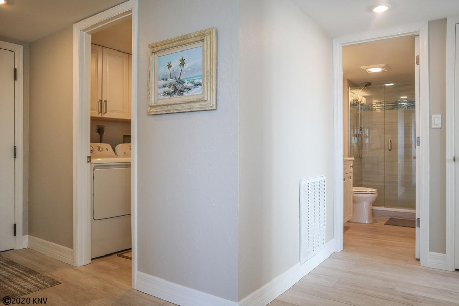 Opposite end of the condo is the Laundry Room and Guest Bedroom and Bath