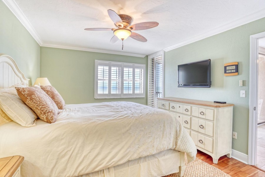 Master Bedroom features its own TV and private lanai access