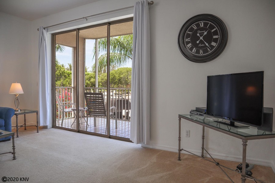 Tall sliding glass doors lead to a huge screened in lanai with waterfront views