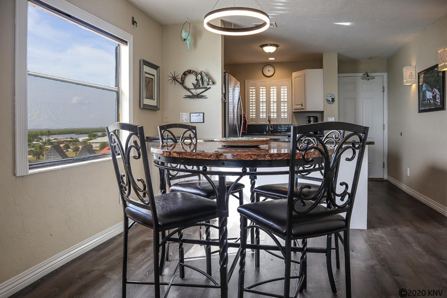Open floor plan features a light filled dining area
