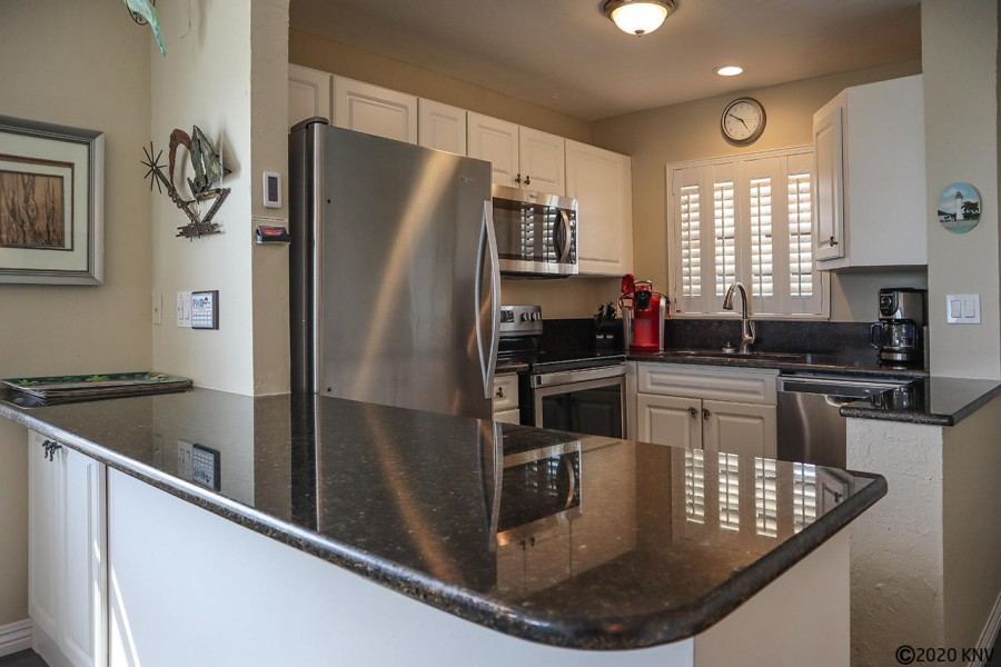 Fully Equipped Kitchen features granite countertops and stainless steel appliances.