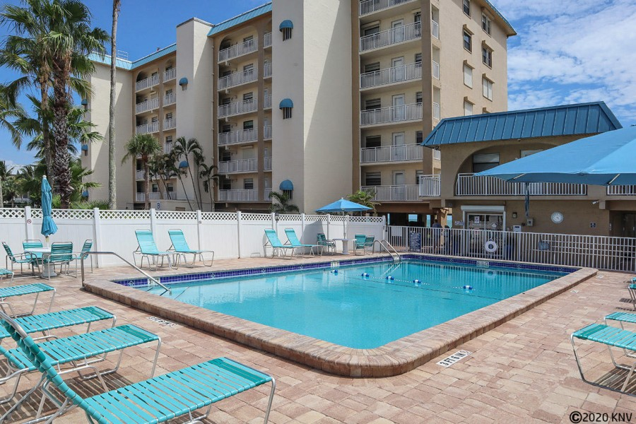 Smugglers Cove Beachfront Condos offers a heated pool and sundeck with lounge chairs