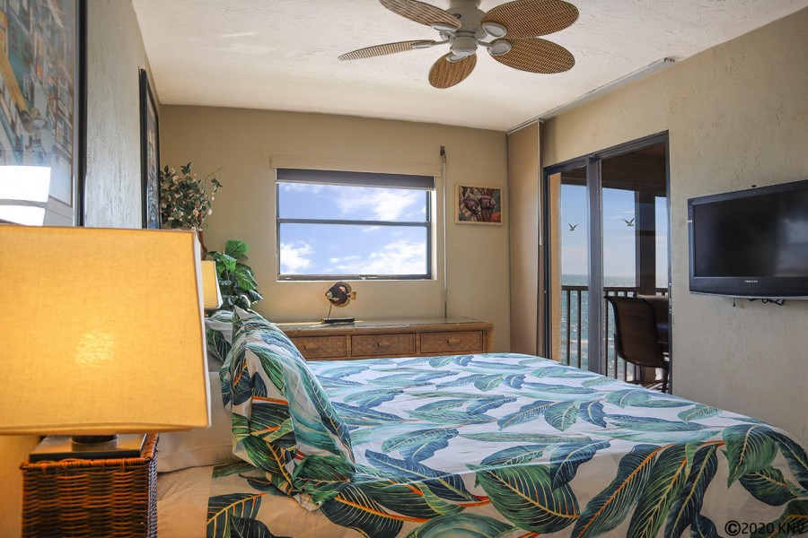 Master Bedroom has its own TV and a private lanai access.