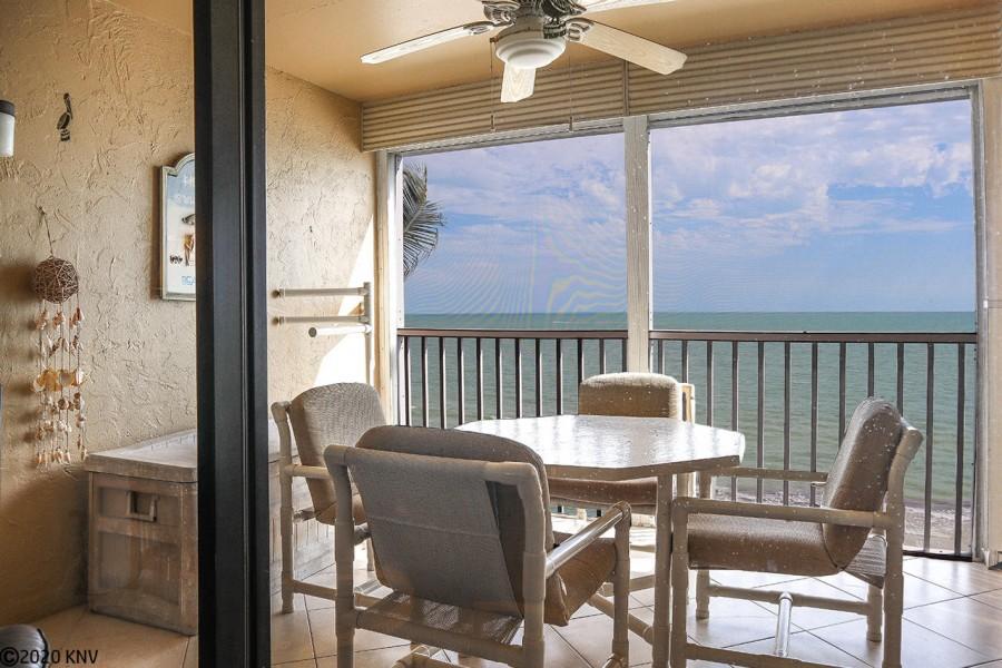 Wonderful screened in lanai enjoys a panoramic view of the Gulf
