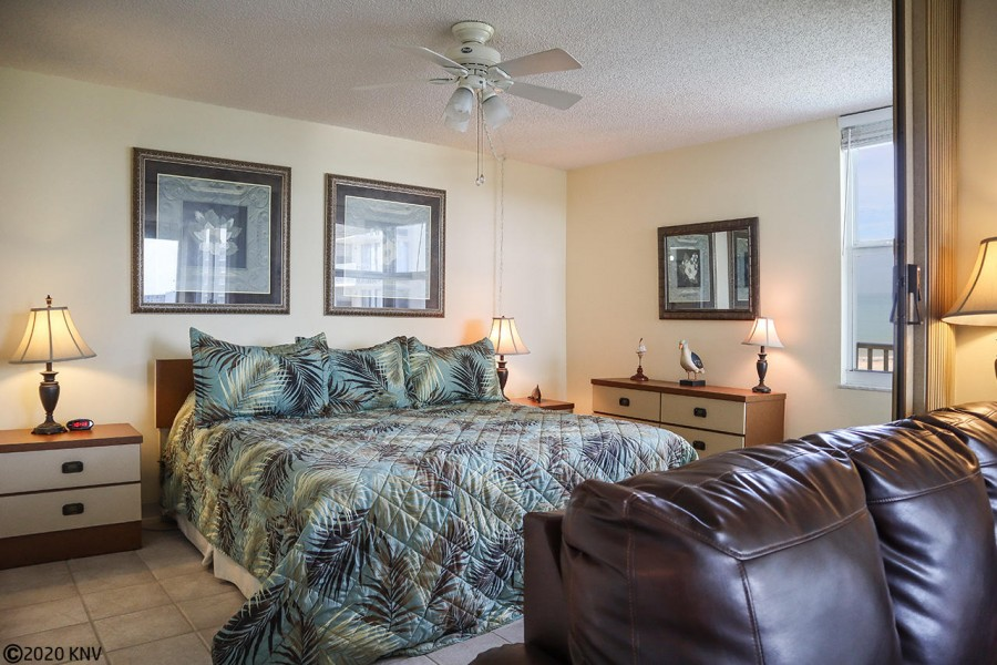 Bedroom has ceiling fan and view of the Gulf.