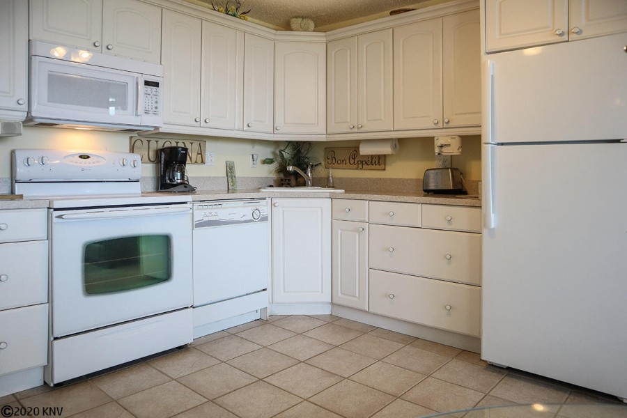 Kitchen includes all appliances, including a dishwasher