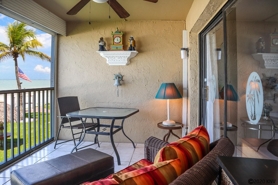 Wonderful screened in lanai features comfortable seating and ceiling fan.