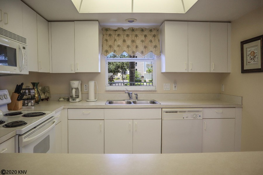 Large clean kitchen is fully equipped.