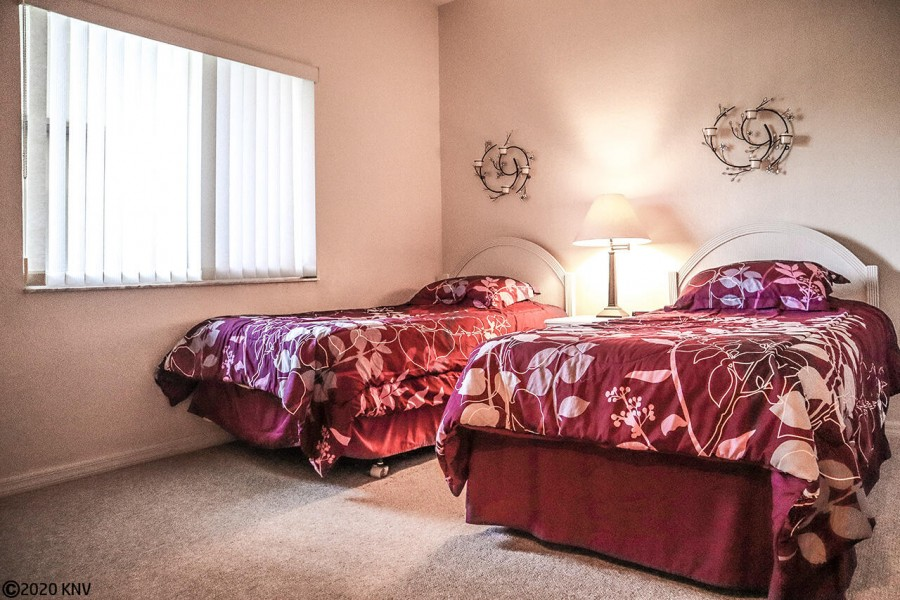Located at the opposite end of the condo, Guest Bedroom with two Twin Beds