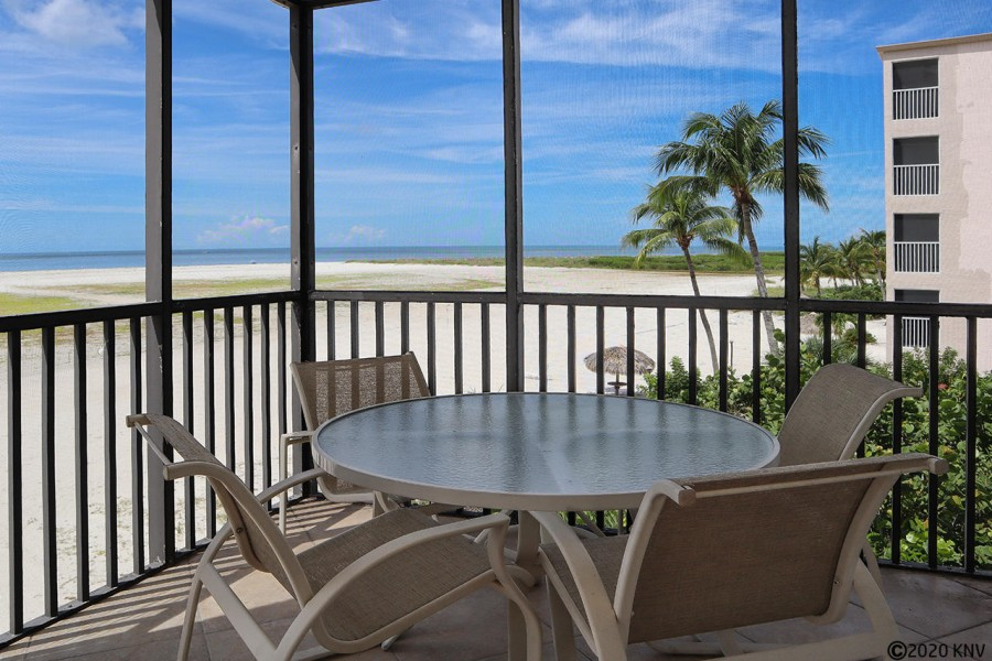 The Huge Wrap Around Screened In Lanai - this wonderful space to dine out or just relax and enjoy th