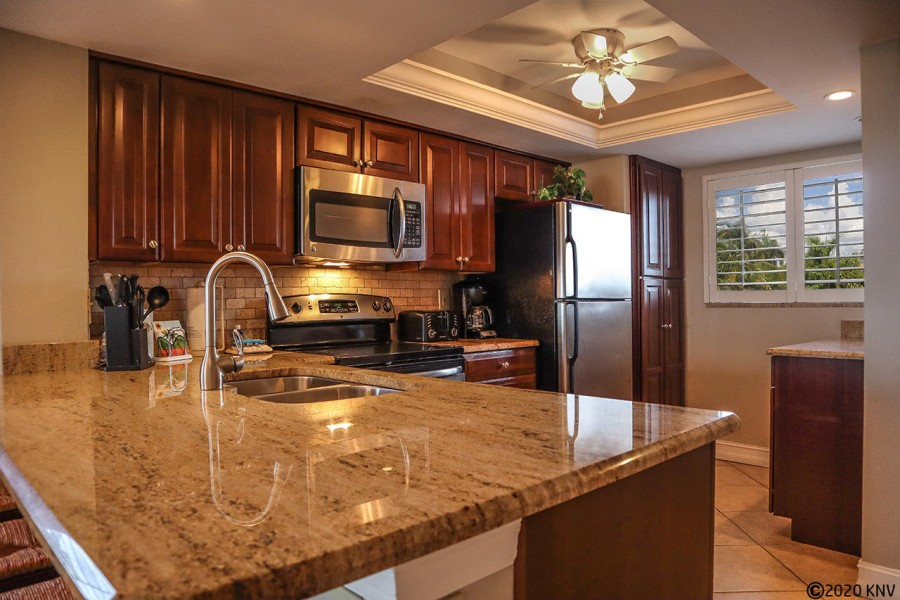 Granite topped counter tops make prepping meals easy.