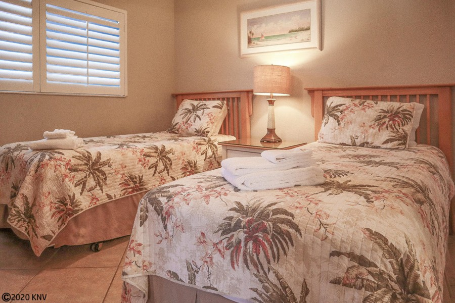 Comfortable Twin Beds outfitted with freshly laundered linens