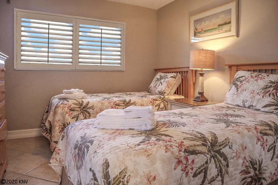Open the plantation shutters to let the sunlight stream in.