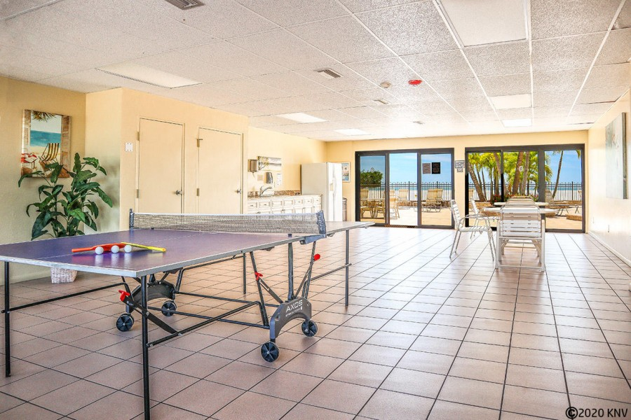 Game room and kitchen facilities next to the pool.