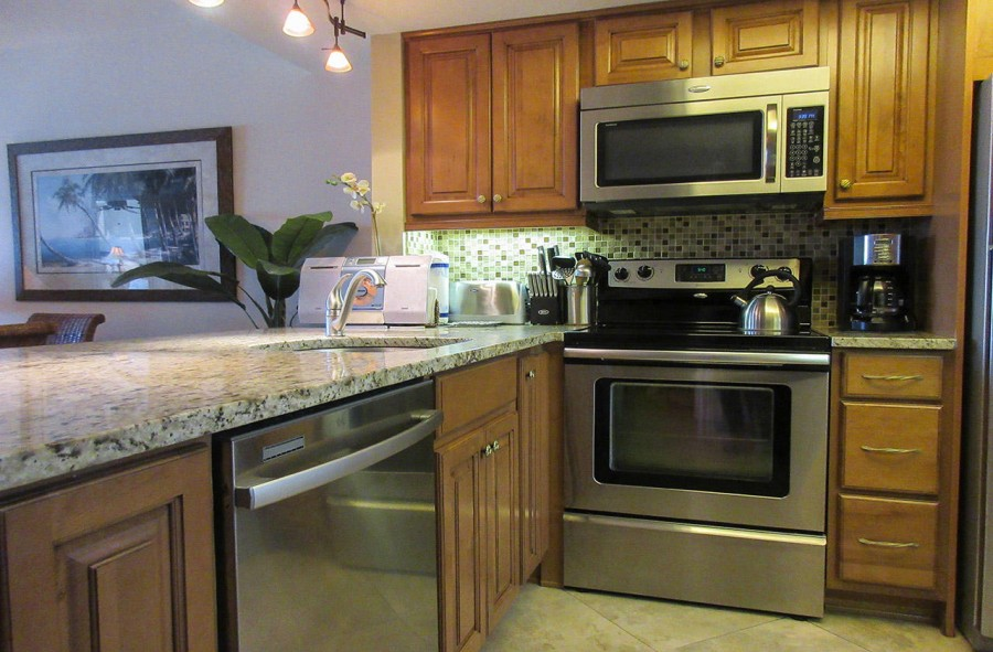 Carlos Pointe 612 Kitchen has new appliances, breakfast bar, granite countertops and in unit washer