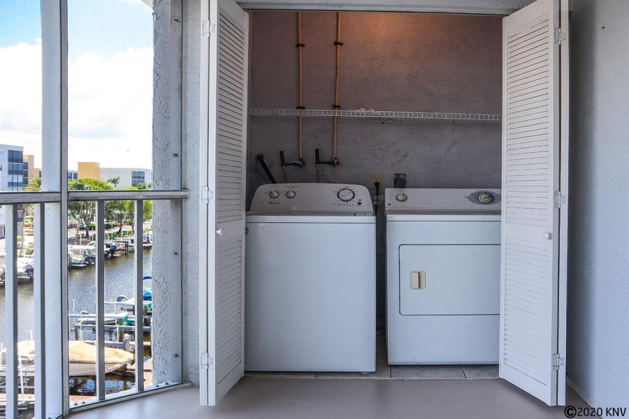 Washer and Dryer for the condo is hidden away out on the lanai.