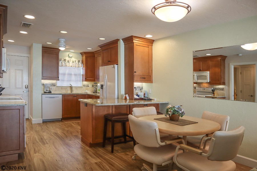 Newly remodeled kitchen has a clean, crisp look in this air-conditioned vacation condo.